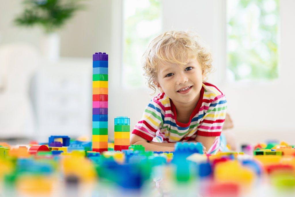 Child playing with toy blocks at a Preschool & Daycare Serving San Antonio, TX
