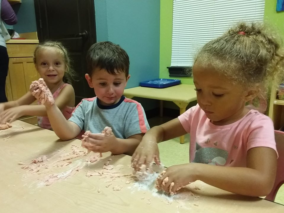 children participating in sensory play at a Preschool & Daycare Serving San Antonio, TX