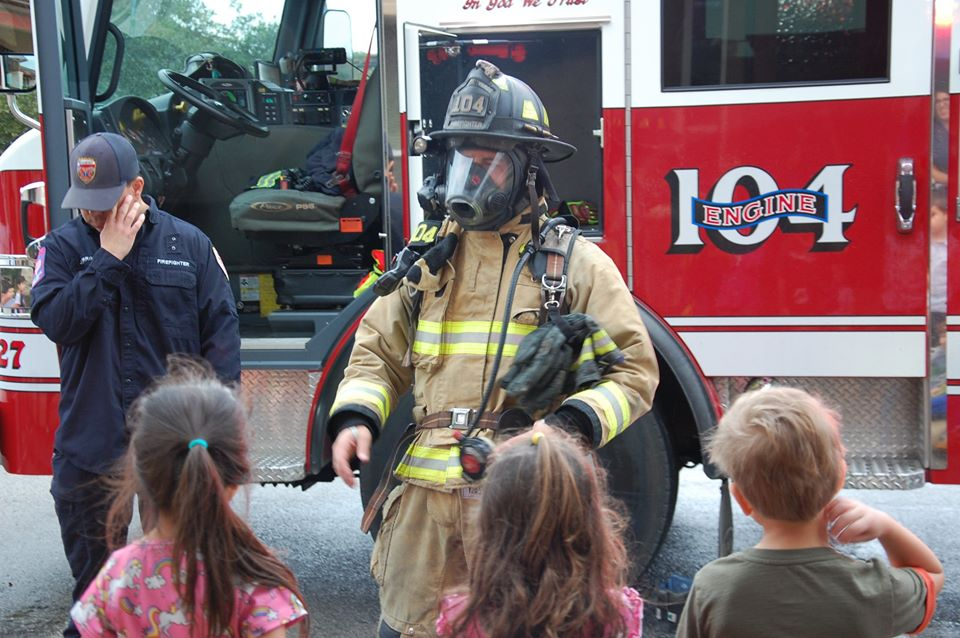 firefighters and children outside at a Preschool & Daycare Serving San Antonio, TX