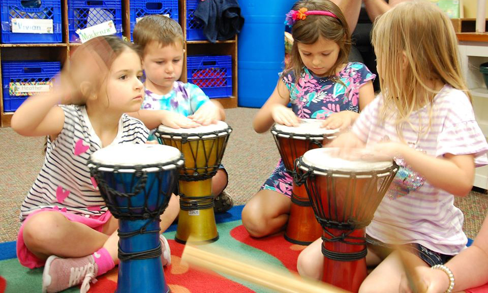 girls playing drums at a Preschool & Daycare Serving San Antonio, TX