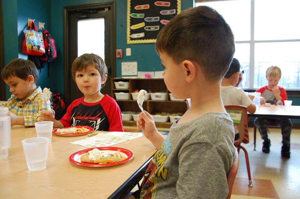 happy boys eating at a Preschool & Daycare Serving San Antonio, TX