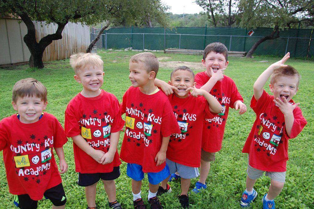 happy boys smiling outside at a Preschool & Daycare Serving San Antonio, TX