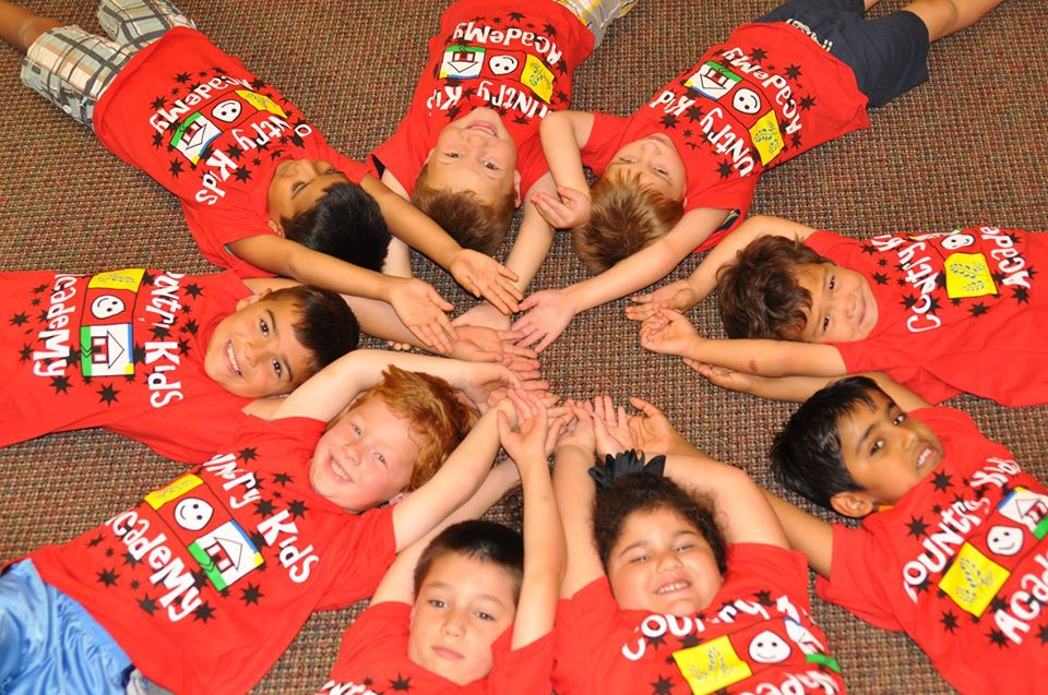 happy children lying on carpet at a Preschool & Daycare Serving San Antonio, TX
