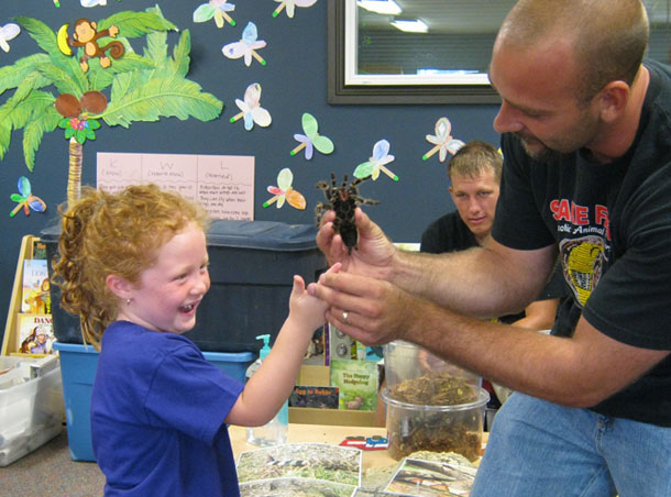 happy girl playing with spider at a Preschool & Daycare Serving San Antonio, TX