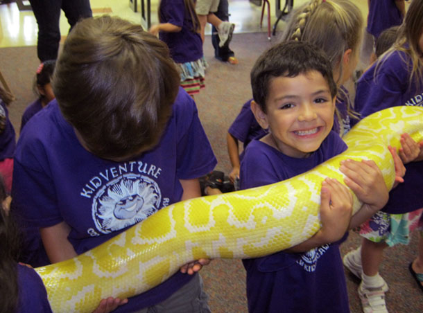 kids holding snake at a Preschool & Daycare Serving San Antonio, TX