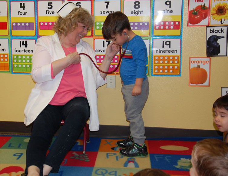 nurse playing with toddler at a Preschool & Daycare Serving San Antonio, TX
