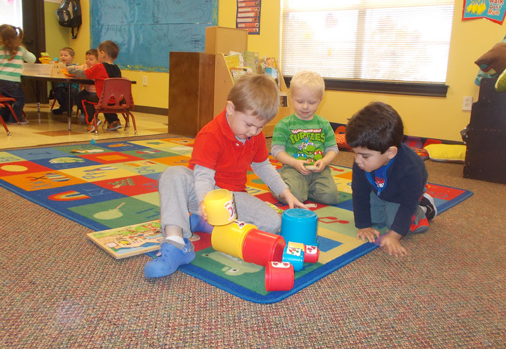 preschool children playing in classroom at a Preschool & Daycare Serving San Antonio, TX