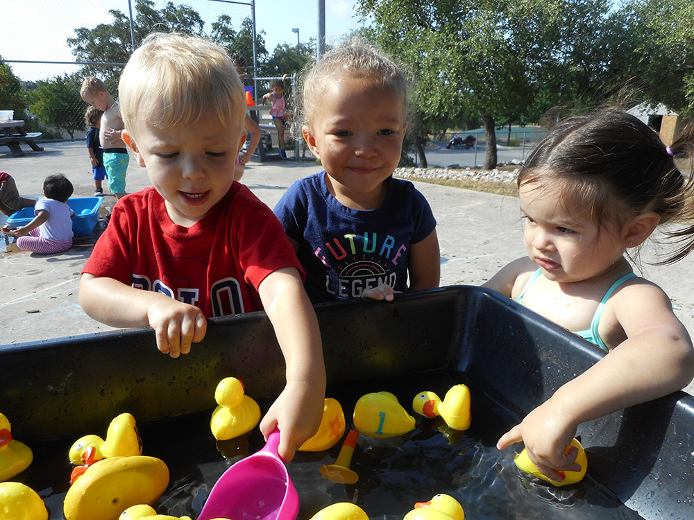 preschoolers having fun outdoor at a Preschool & Daycare Serving San Antonio, TX