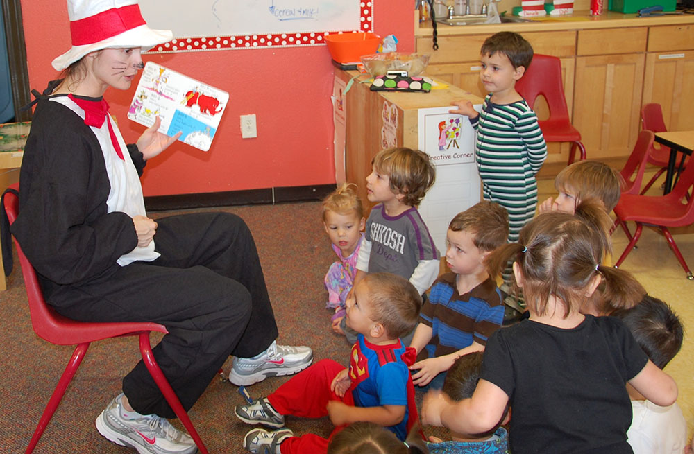 teacher reading book to toddler class at a Preschool & Daycare Serving San Antonio, TX
