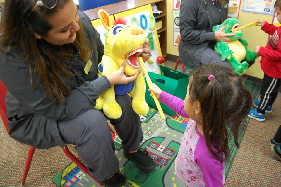 teacher teaching oral health at a Preschool & Daycare Serving San Antonio, TX