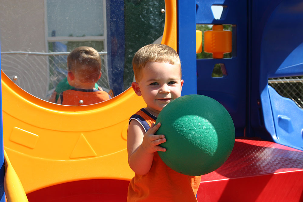 toddler boy playing with ball at a Preschool & Daycare Serving San Antonio, TX