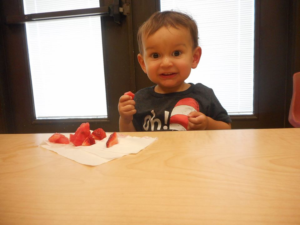toddler eating strawberries at a Preschool & Daycare Serving San Antonio, TX